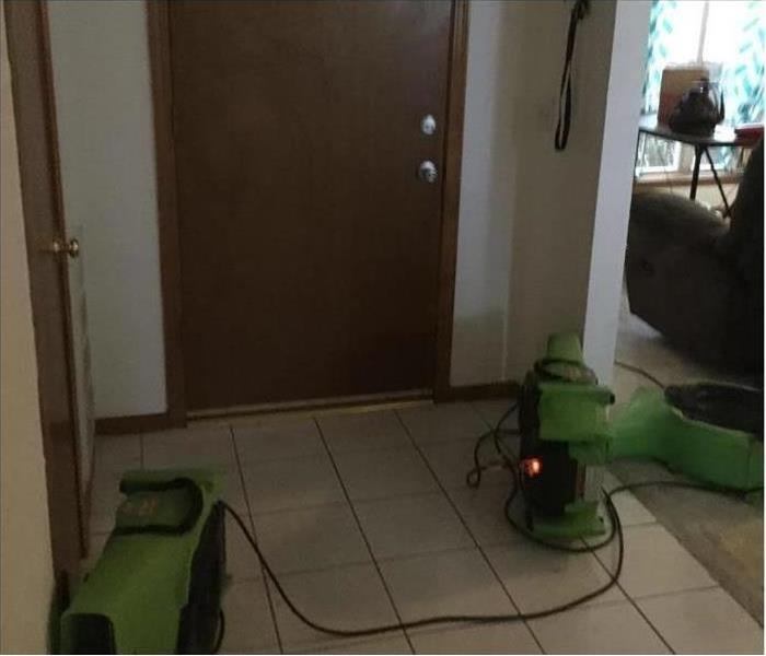 Two air movers placed on floor drying up after water damage