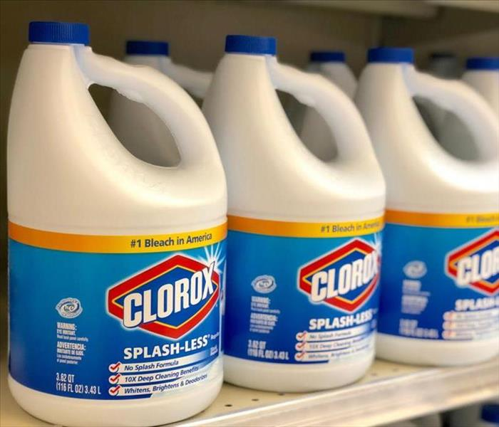 Bottles of Clorox Bleach on store shelves.